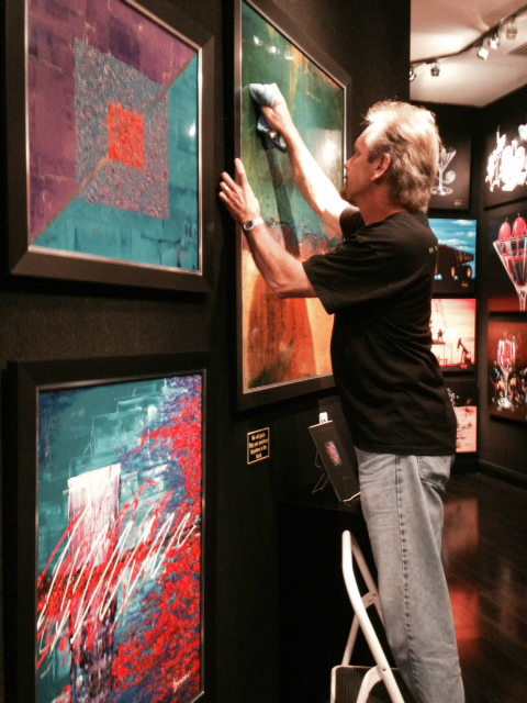 Byron cleaning art at Signature Gallery ay Planet Hollywood 1